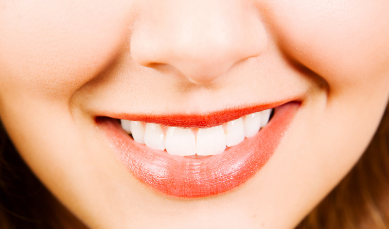 Why Orange Lipstick Causes Your Teeth To Look Yellow
